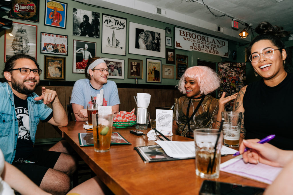 the band chats pleasantly at a table