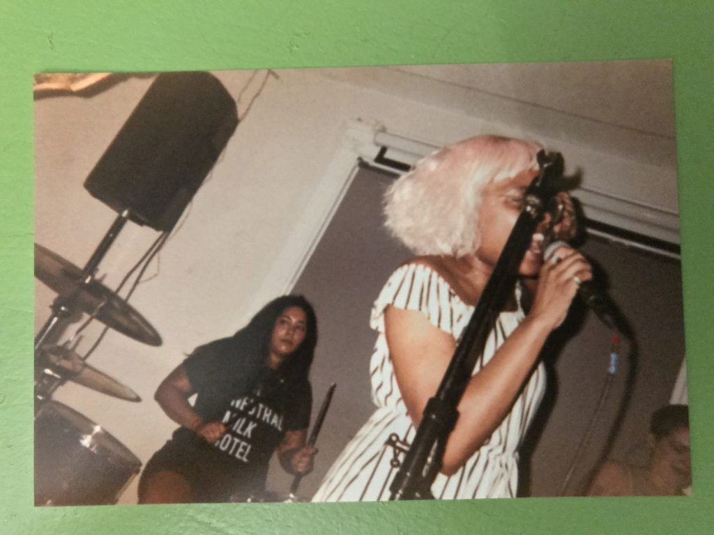 disposable camera photo of Shady singing and Josette drumming at Rhizome