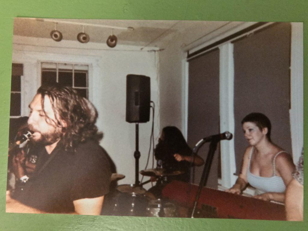 grainy disposable camera photo of MattyK playing sax and Vitamin Dee playing keyboard and singing at Rhizome