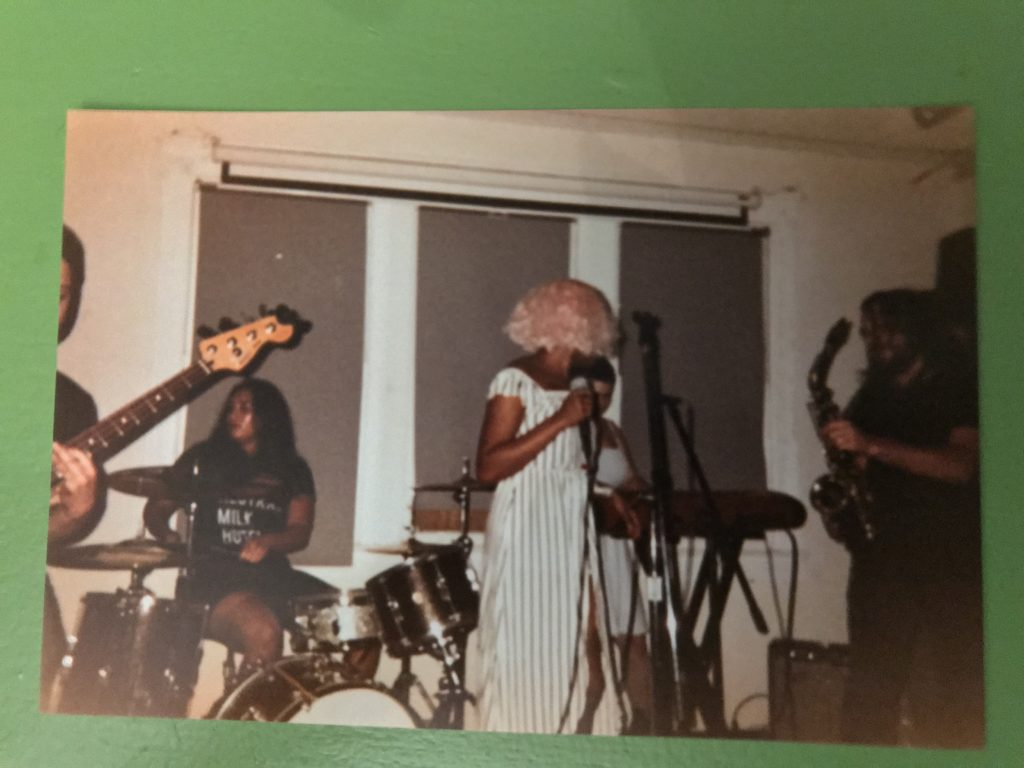 grainy disposable camera photo of Shady, Beck, Josette, and Frankie playing at Rhizome